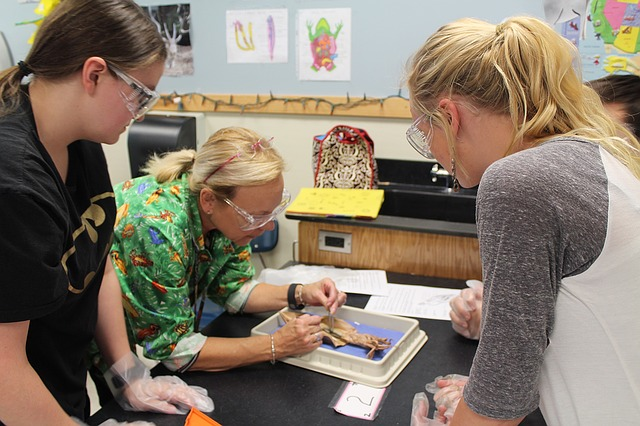 Teacher in science lab with students.
